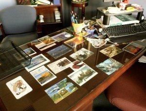 postcards-under-desk-two-decorating-office