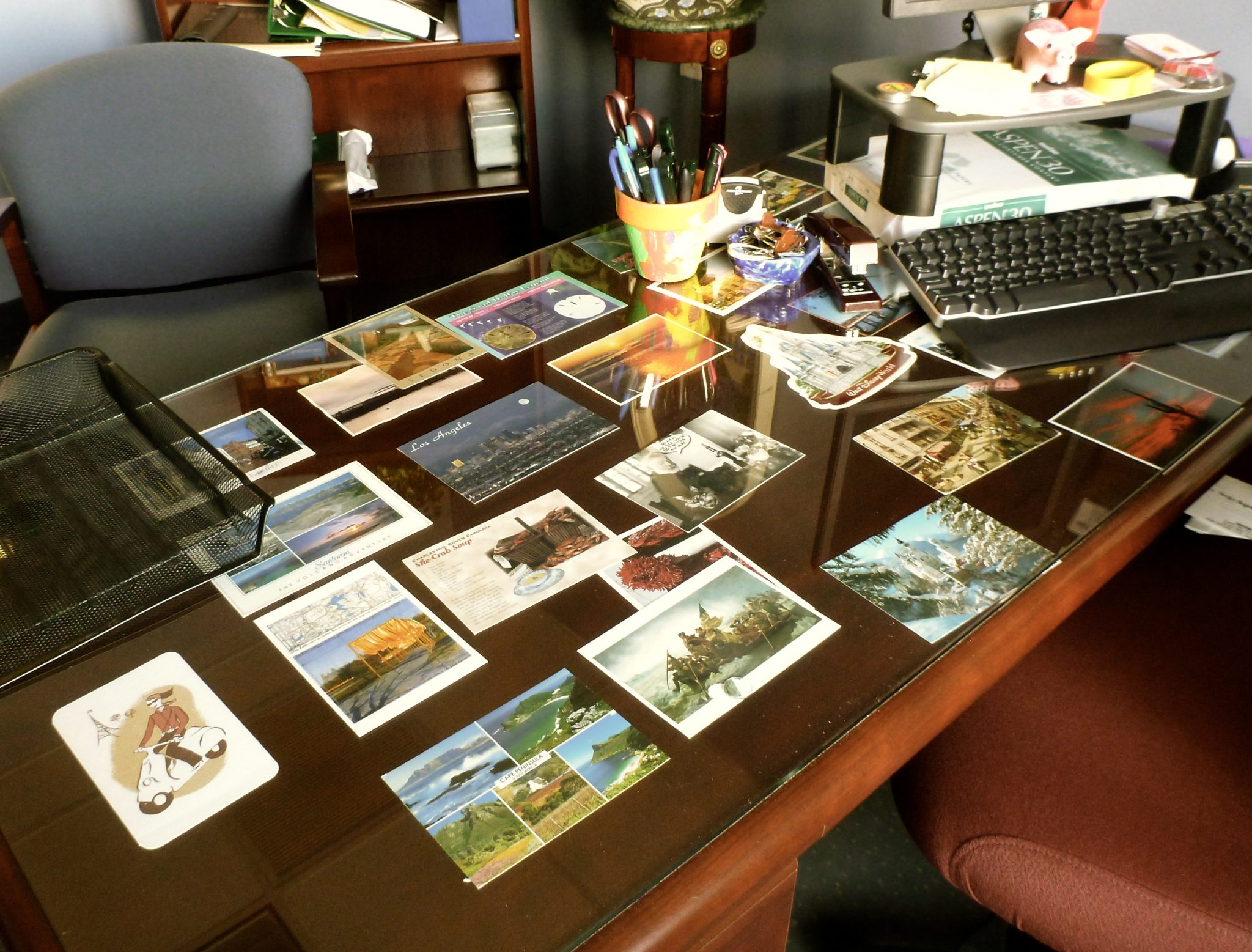 postcards-under-desk-two-decorating-office