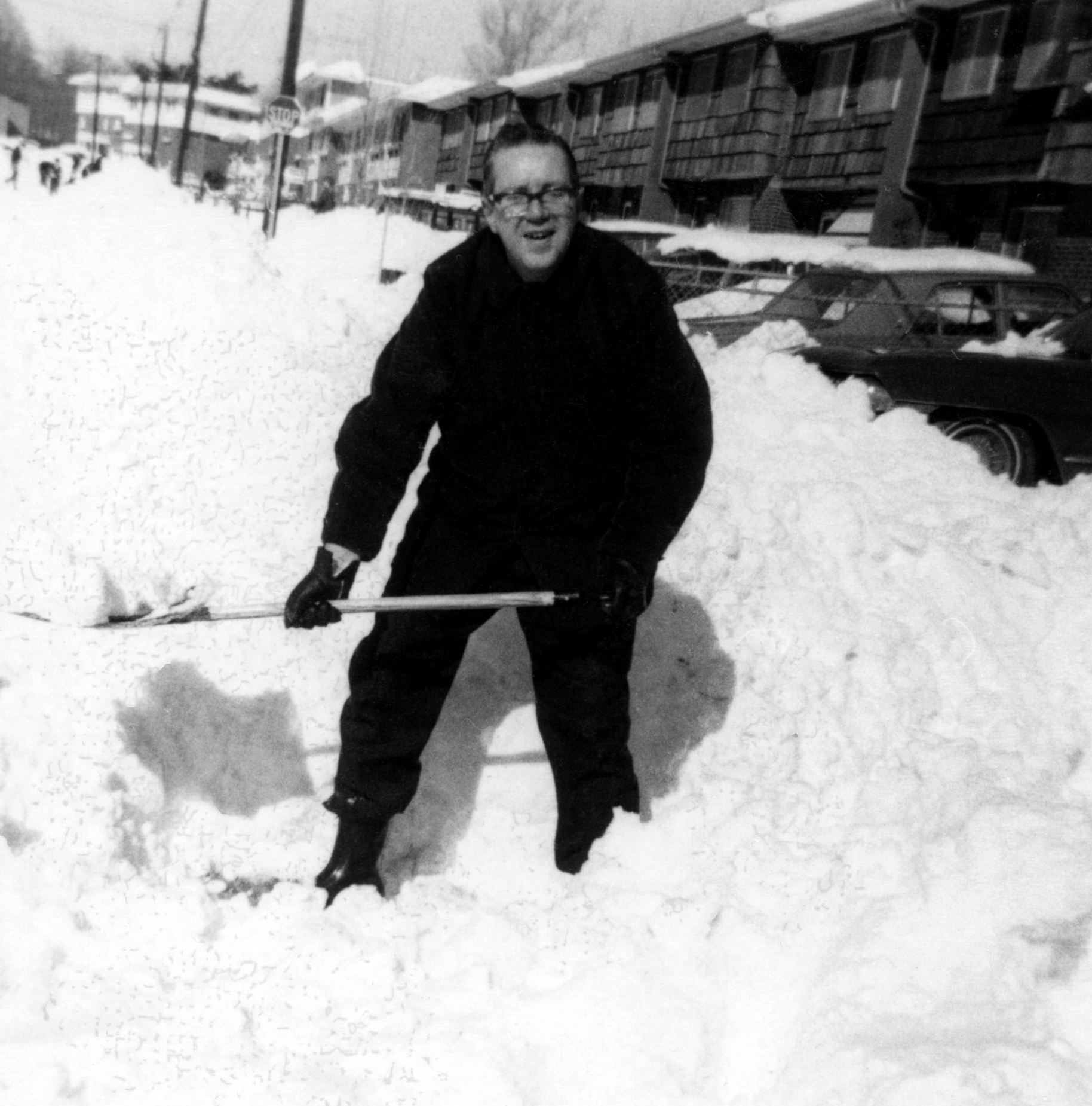 1970's New York man shoveling snow winter road trip