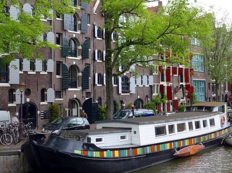 Houseboat in an Amsterdam canal viewed during an Eating Amsterdam Dutch food tour.