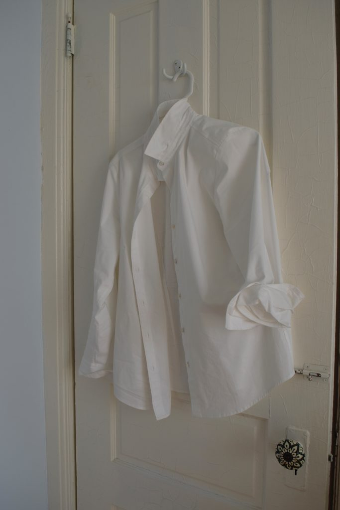 A classic, versatile item like a white button down is the secret to packing light.