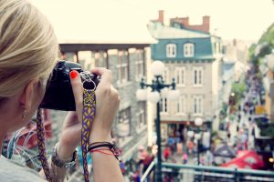 woman with camera in quebec city