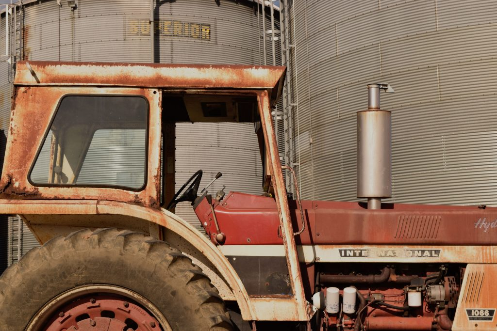 Photo tips for beginners include choosing the right subject, like this red, rusty tractor.