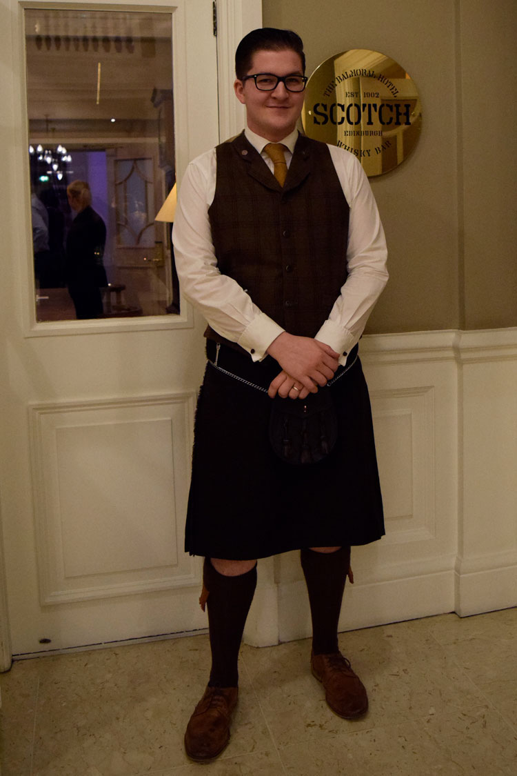 Man in kilt outside bar at The Balmoral Hotel, site of Edinburgh scotch tasting