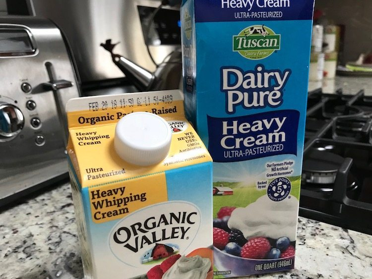 two containers of heavy cream, the essential ingredient for making whipped cream at home