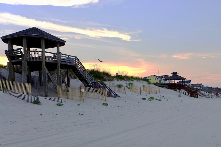 one of the best east coast beaches in the u.s. is the outer banks in north carolina here at sunset