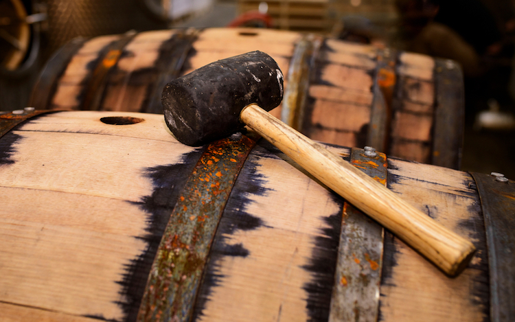Whiskey Barrel and mallet, two items necessary when considering used whiskey barrel ideas